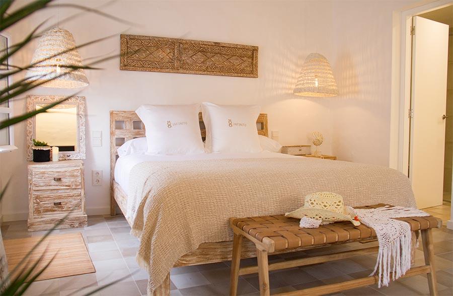 hotel menorca infinito habitaciones cama